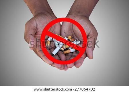 concept Quit smoking two hand man hold cigarette - stock photo