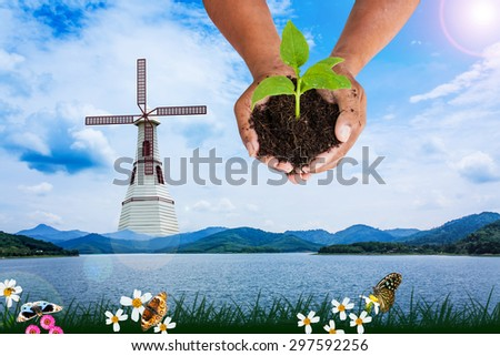concept save the world,renewable energy natural from wind turbine generating electricity - stock photo