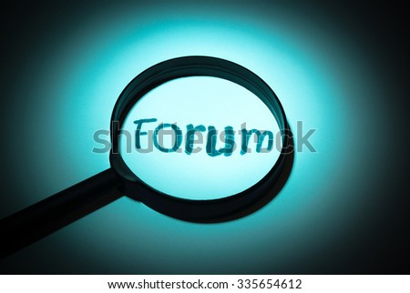 Concept search loupe magnifier forum button - stock photo