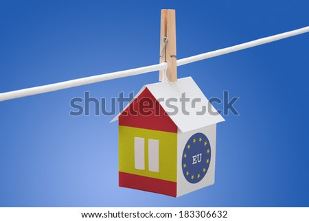 concept - Spain, Spanish and EU flag painted on a paper house hanging on a rope - stock photo