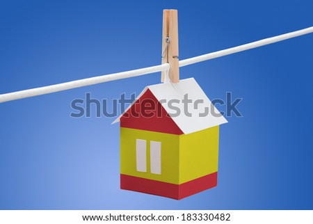 concept - Spain, Spanish flag painted on a paper house hanging on a rope - stock photo