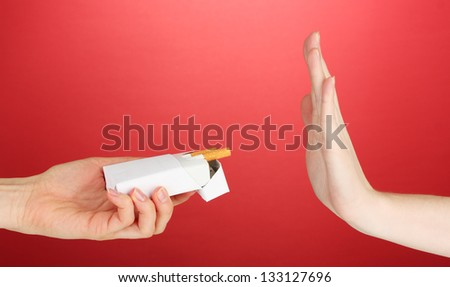 Concept: stop smoking, on red background - stock photo
