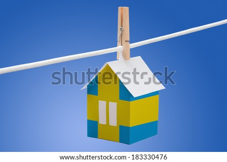 concept - sweden, swedish flag painted on a paper house hanging on a rope - stock photo