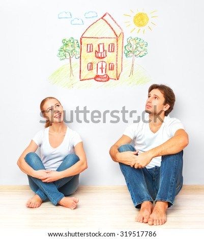 Concept: The housing and mortgage for young families. couple dreaming of his home - stock photo