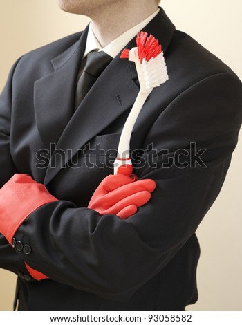 Concept to illustrate: Business man doing domestic chores. Focus on utensil. - stock photo