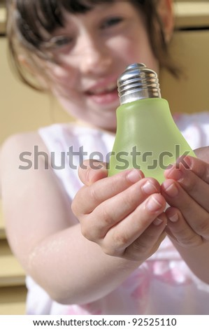 Concept to illustrate the harnessing of a child's energy as a natural resource. - stock photo