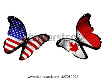Concept - two butterflies with USA and Canada flags flying - stock photo