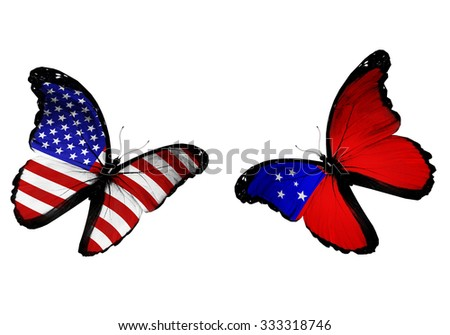 Concept - two butterflies with USA and Samoa  flags flying