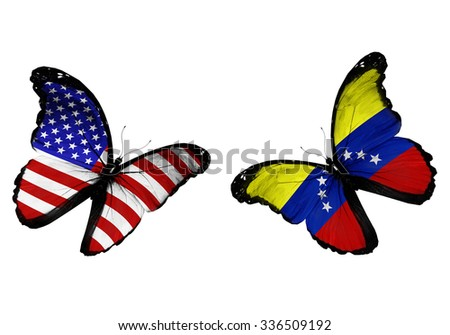 Concept - two butterflies with USA and Venezuela  flags flying