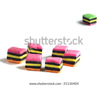 Concept using licorice allsorts - left out of the group - stock photo