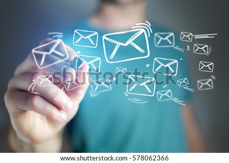Concept view of man drawing email icon on technology interface