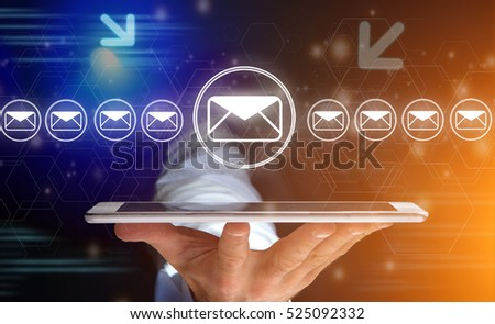 Concept view of sending message with smartphone with email icon around