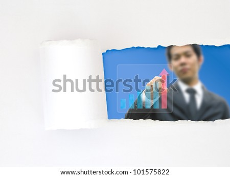 Concept white paper and business man pointing a graph - stock photo