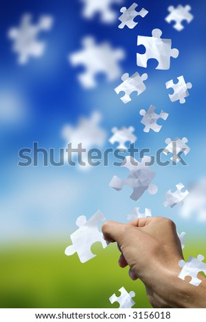 Concept with a man catching a falling puzzle piece. - stock photo
