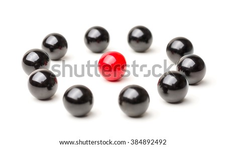 Concept with red and black marbles -  Being the center point