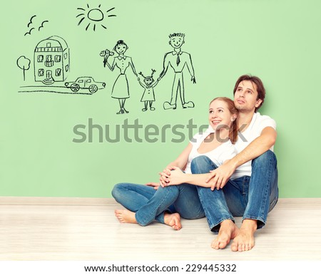 concept. young happy family couple dreaming of new house, car, child, financial well-being - stock photo