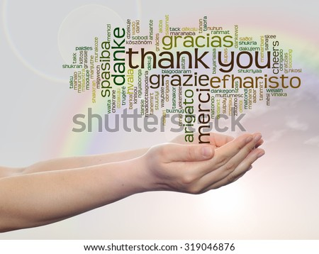 Conceptual abstract thank you word cloud held in hands different language, multilingual metaphor to education, thanksgiving day, appreciation, multicultural, friendship, tourism travel on rainbow sky - stock photo