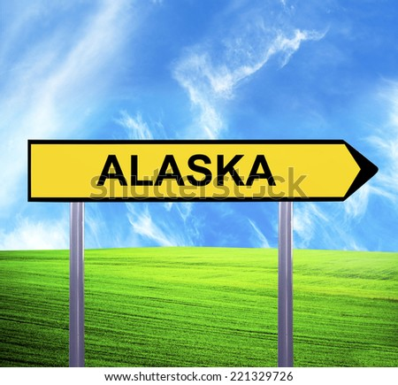 Conceptual arrow sign against beautiful landscape with text - ALASKA - stock photo