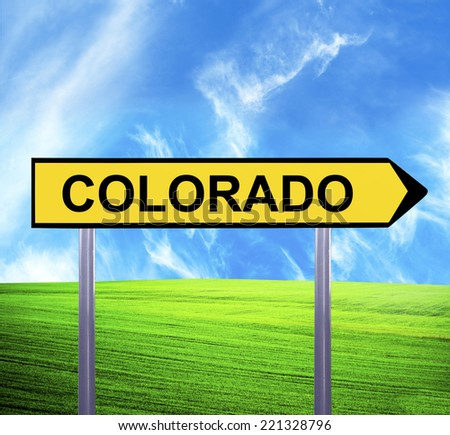 Conceptual arrow sign against beautiful landscape with text - COLORADO - stock photo
