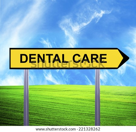 Conceptual arrow sign against beautiful landscape with text - DENTAL CARE - stock photo