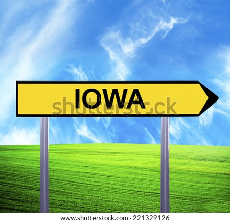 Conceptual arrow sign against beautiful landscape with text - IOWA - stock photo