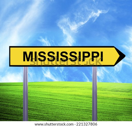 Conceptual arrow sign against beautiful landscape with text - MISSISSIPPI - stock photo