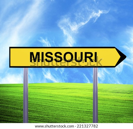 Conceptual arrow sign against beautiful landscape with text - MISSOURI - stock photo