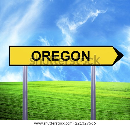 Conceptual arrow sign against beautiful landscape with text - OREGON - stock photo