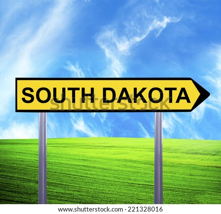 Conceptual arrow sign against beautiful landscape with text - SOUTH DAKOTA - stock photo