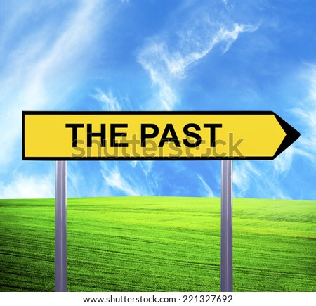 Conceptual arrow sign against beautiful landscape with text - THE PAST - stock photo
