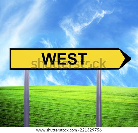 Conceptual arrow sign against beautiful landscape with text - WEST - stock photo