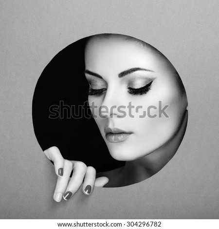 Conceptual beauty portrait of beautiful young woman. Perfect Manicure.  Cosmetic Eyeshadows. Fashion photo. Black and white - stock photo