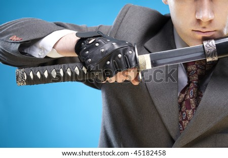Conceptual business image. Young businessman close-up ready to start business struggle - stock photo