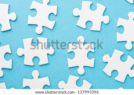 Conceptual closeup image of white and blank pieces of a puzzle - stock photo