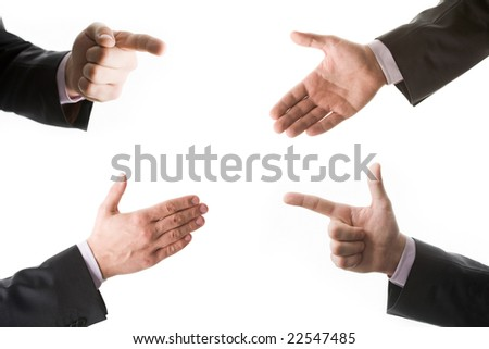 Conceptual collage of four hands in suit - stock photo