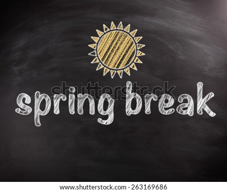 Conceptual Handwritten Spring Break Texts on Black Chalkboard with Sun Drawing Design - stock photo