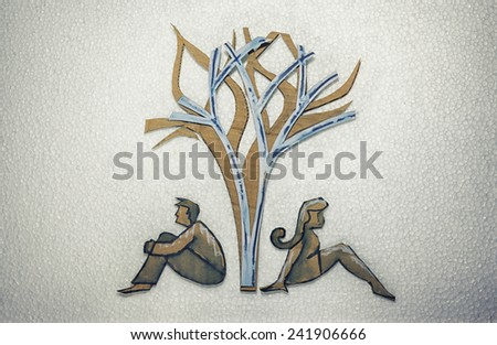 Conceptual illustration.  Cut out cardboard silhouette of people or signs on different background  - stock photo