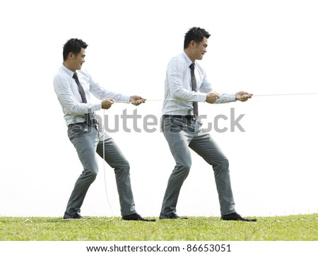 Conceptual image, Asian Business people playing tug of war