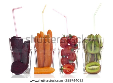 Conceptual image - fresh fruits and vegetables in glass cups on a white background. - stock photo