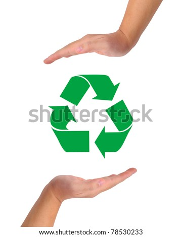 Conceptual image, help and care for recycling. Two hands isolated on white with recycle icon in the middle. - stock photo