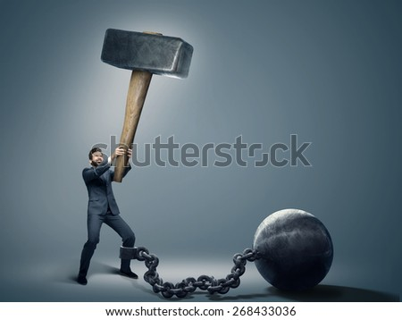 Conceptual image of a businessman holding big hammer - stock photo