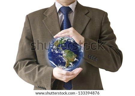 Conceptual image of a businessman holding the globe isolated on white background. Elements of this image furnished by NASA.