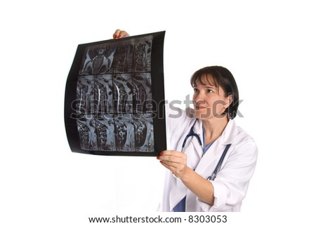 Conceptual image of a doctor reviewing a patient's MRI. Intended for any use where a medical inference is needed.