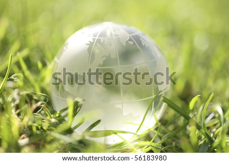 conceptual image of a globe on grass - stock photo