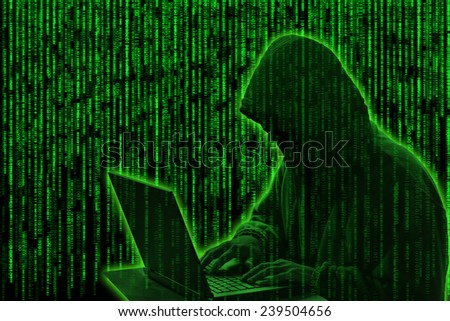 Conceptual image of a hacker on matrix background of falling green computer code digits