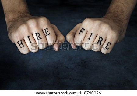 "Conceptual image of a man with ""HIRE"" and ""FIRE"" fake tattoos."