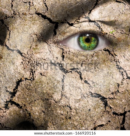 Conceptual image of a mud cracked face can be used for different concepts - stock photo