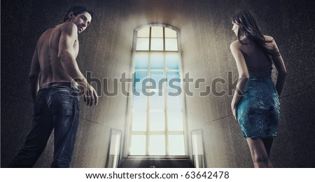 Conceptual image of a young couple stepping into the window light - stock photo