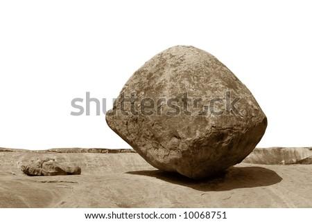 Conceptual image of an isolated balancing rock in Mahabalipuram, India - stock photo