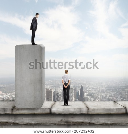Conceptual image of businessman standing on bar and looking down at woman